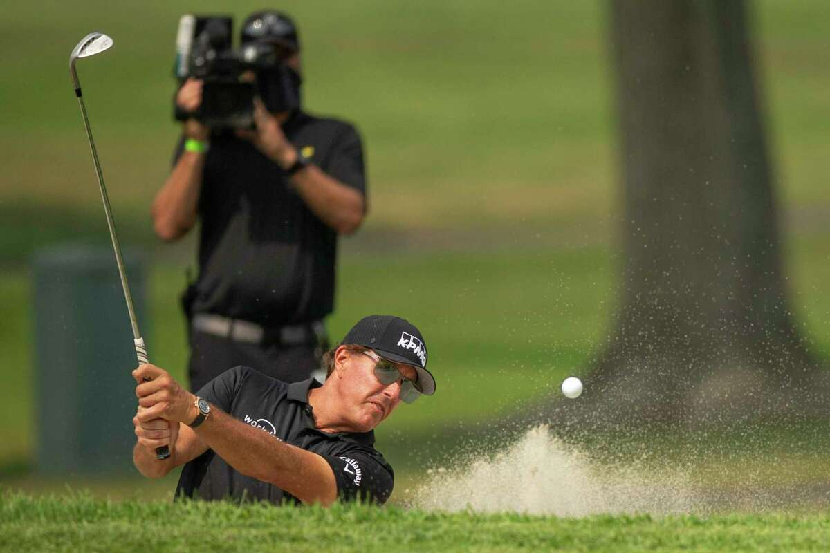 Phil Mickelson blasts out of a bunker on No. 16 during the Safeway Open at Silverado Resort on Sept. 13, 2020.