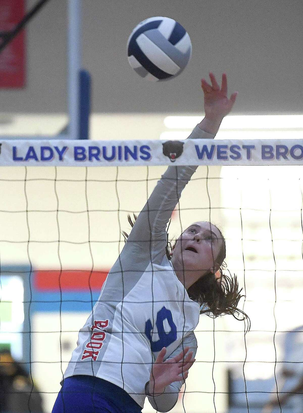 West Brook's Annalise Burbank spikes the ball against Beaumont United during Tuesday's match-up at West Brook. Photo made Tuesday, August 31, 2021 Kim Brent/The Enterprise