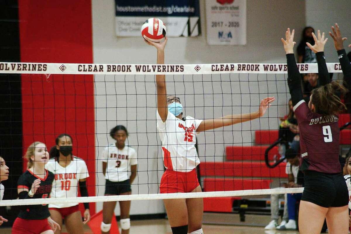 Clear Brook's Kennedy Thompson (15) tries to tip the ball past Summer Creek's Madelyn Troy (9) Tuesday at Clear Brook High School.