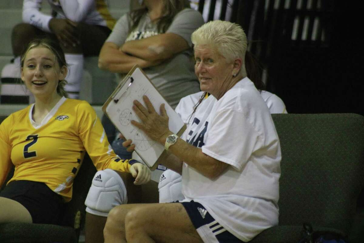 Lynn Perry, the former longtime Pasadena ISD volleyball head coach, tells a Grace Christian Academy server where on the court to deliver the ball Tuesday night.