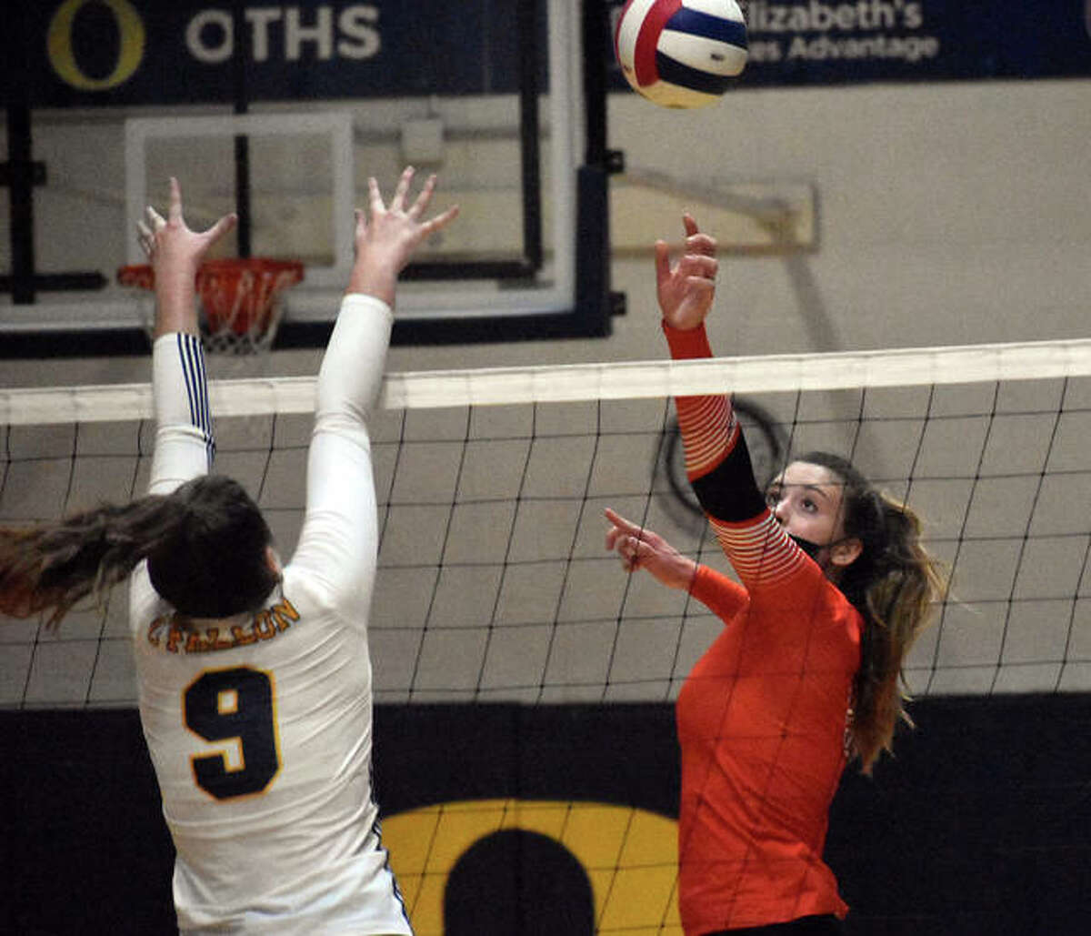 Edwardsville senior Gabby Saye tips over one of her 10 kills on the night against the O'Fallon Panthers on Tuesday in O'Fallon.
