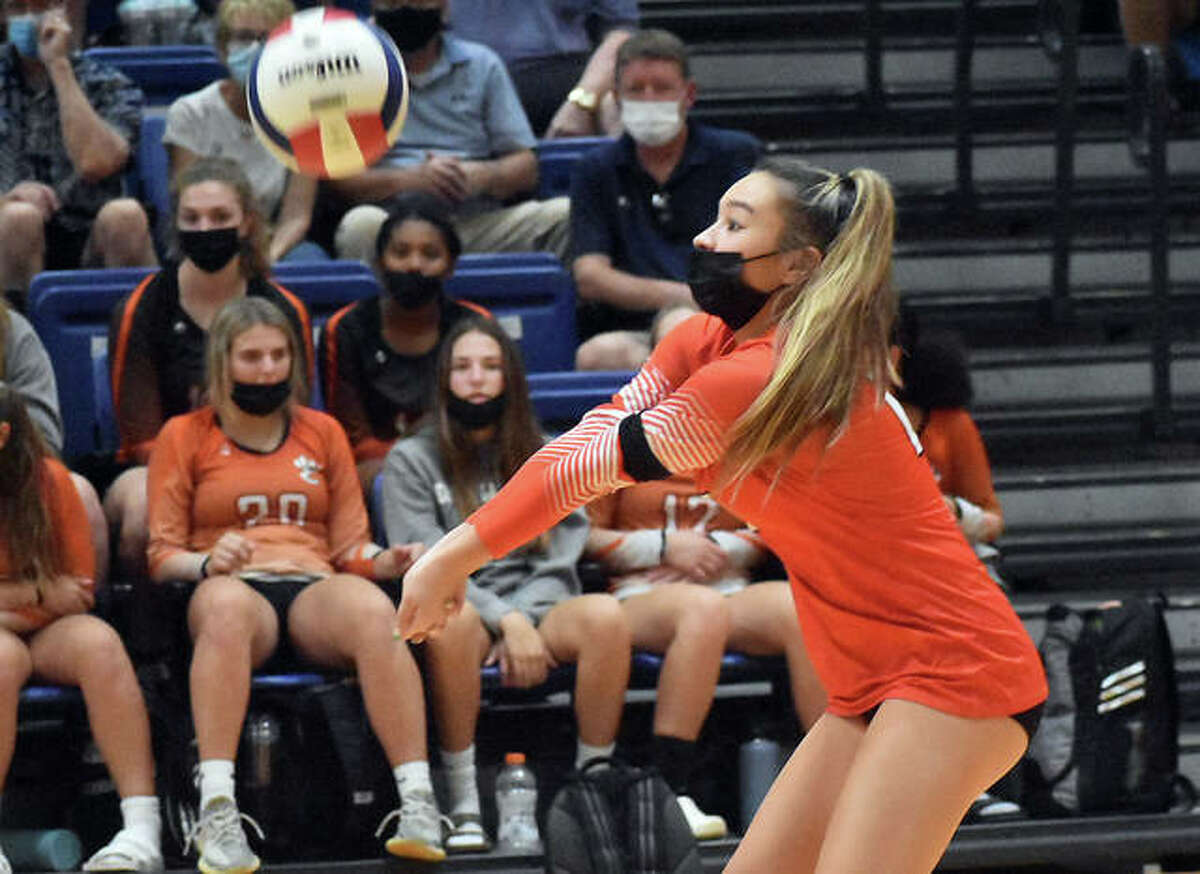 Edwardsville's Hannah Matarelli receives a serve during the first game against the O'Fallon Panthers on Tuesday in O'Fallon.