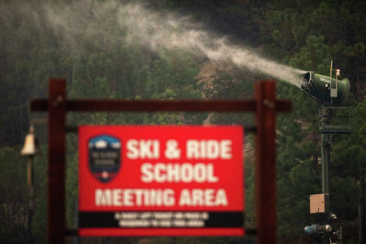 Snow machines saturate vegetation Tuesday to help protect Heavenly Mountain Resort in South Lake Tahoe from the approaching Caldor Fire.