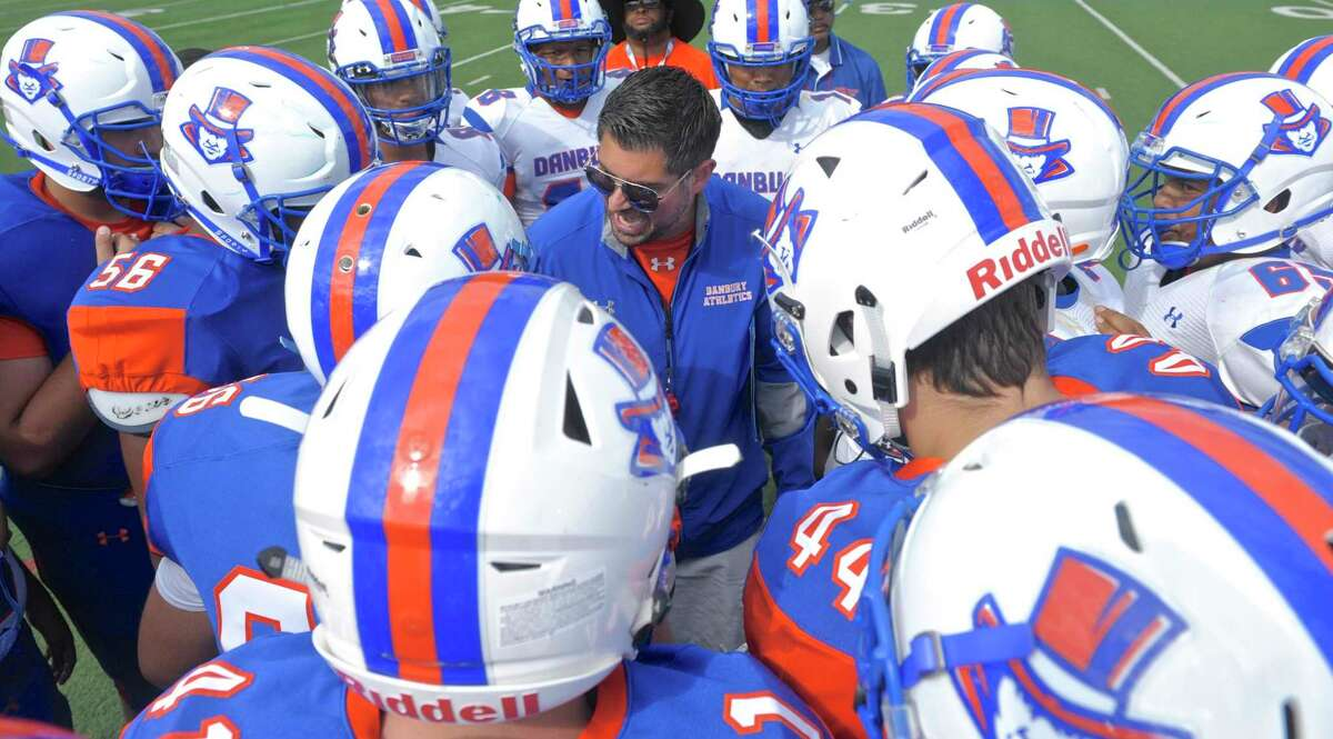 Danbury coach Augustine Tieri talks with his players before the start of the the annual Blue-White Scrimmage in 2018.