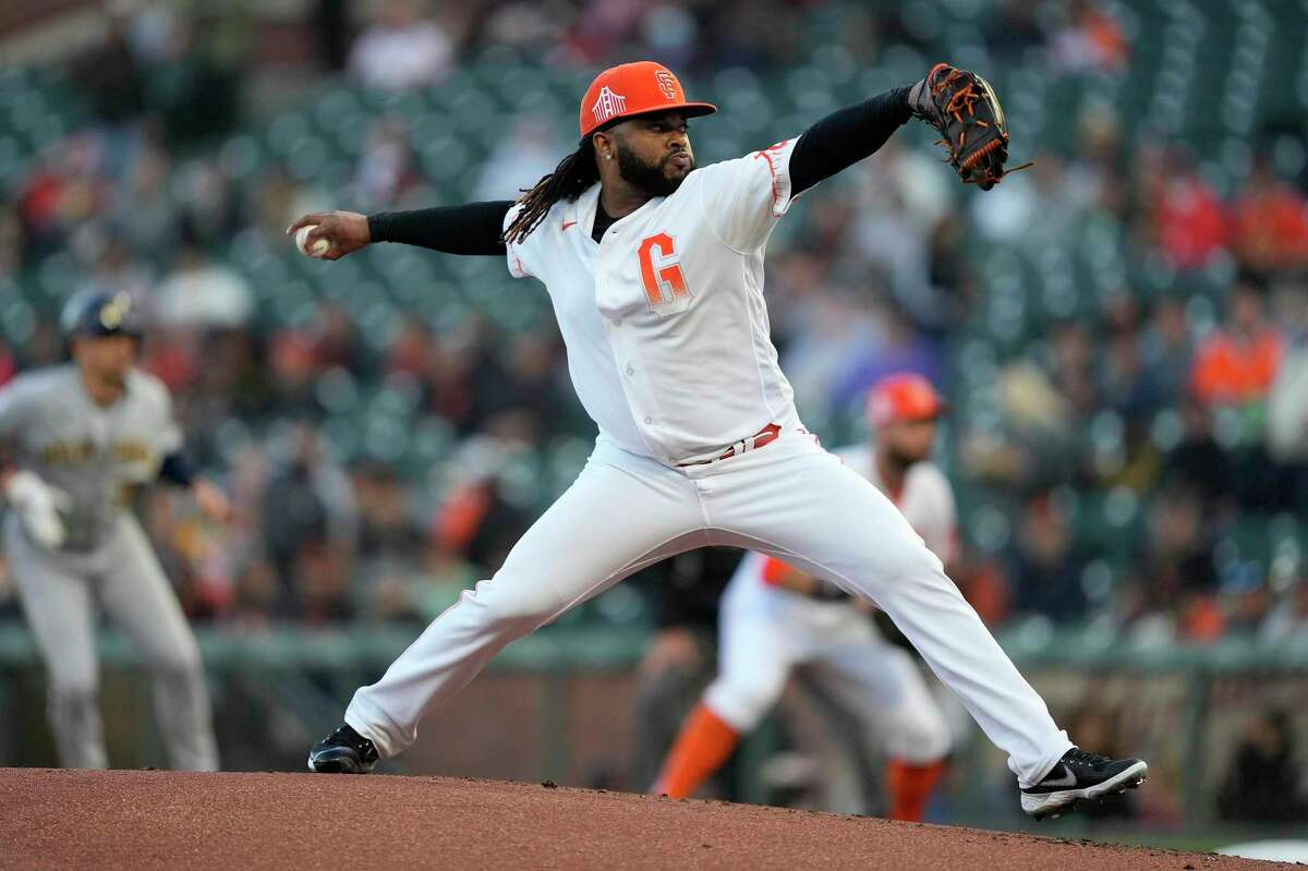 San Francisco Giants pitcher Johnny Cueto pitches against the Milwaukee Brewers during the first inning of a baseball game Tuesday, Aug. 31, 2021, in San Francisco. (AP Photo/Tony Avelar)