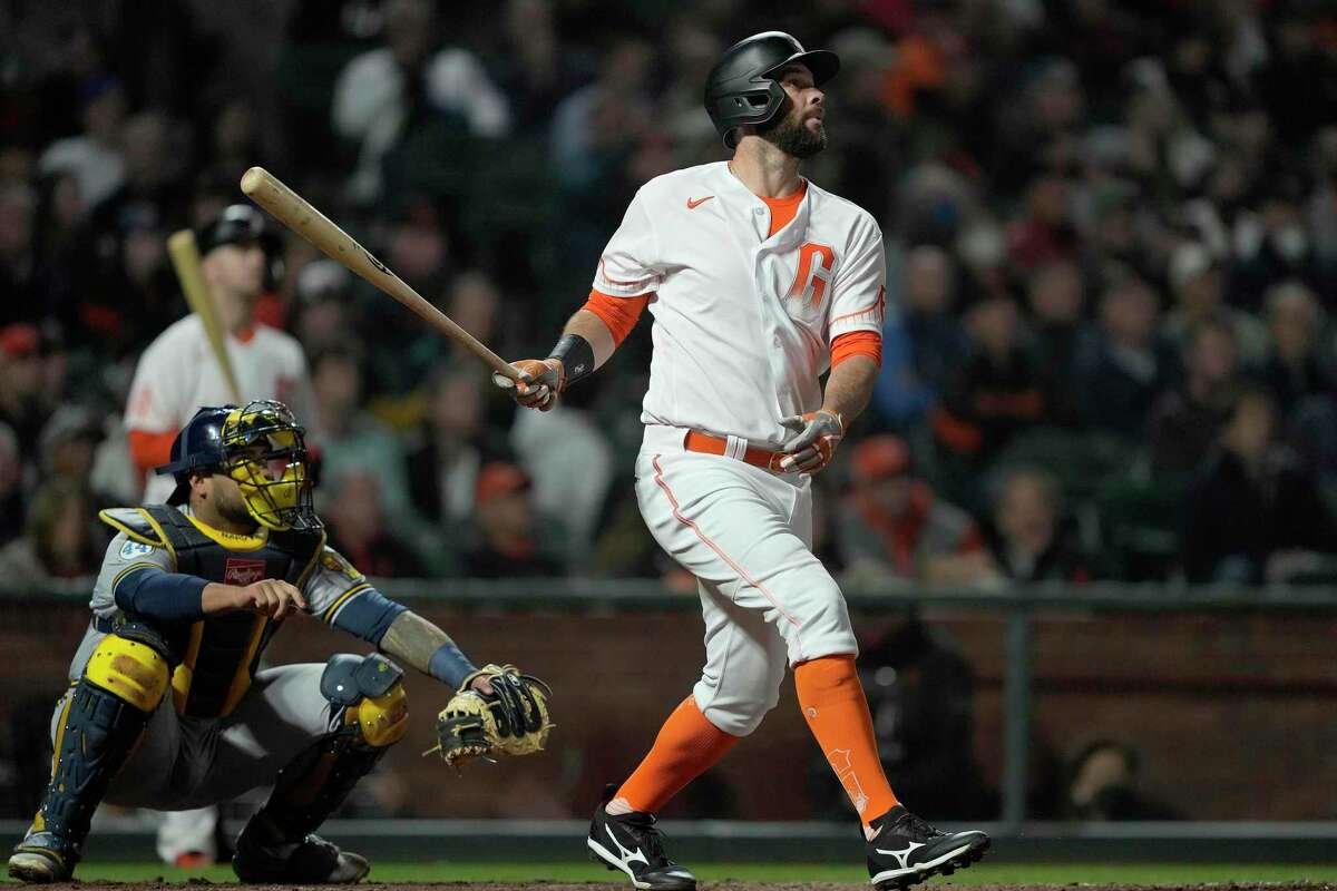San Francisco Giants' Brandon Belt (9) hits a solo home run against the Milwaukee Brewers during the sixth inning of a baseball game Tuesday, Aug. 31, 2021, in San Francisco. (AP Photo/Tony Avelar)