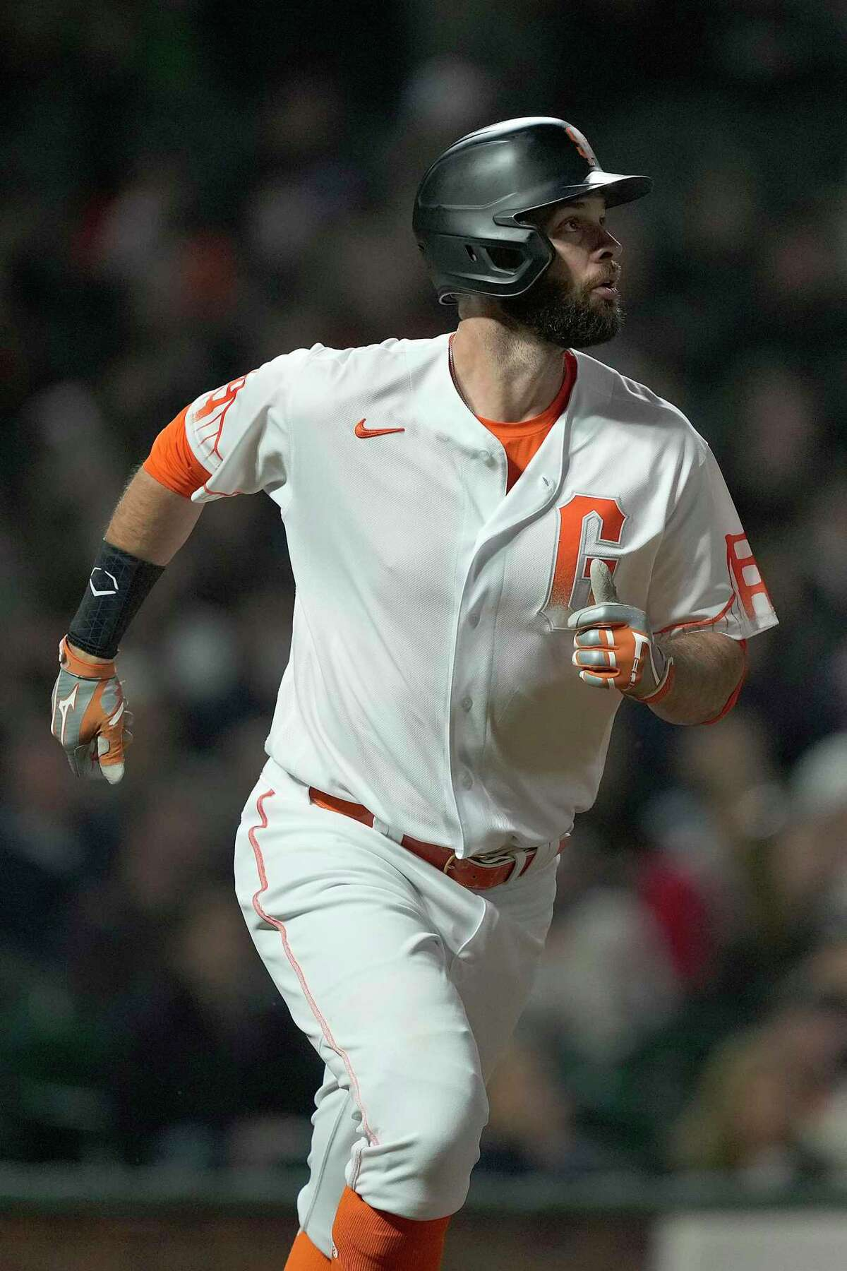 San Francisco Giants' Brandon Belt watches his solo home run against the Milwaukee Brewers during the sixth inning of a baseball game Tuesday, Aug. 31, 2021, in San Francisco. (AP Photo/Tony Avelar)