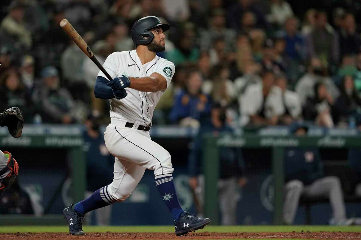 The Mariners' Abraham Toro, a former Astro, watches his grand slam off reliever Kendall Graveman, who went to Houston in the deal that sent Toro to Seattle, on Tuesday night.