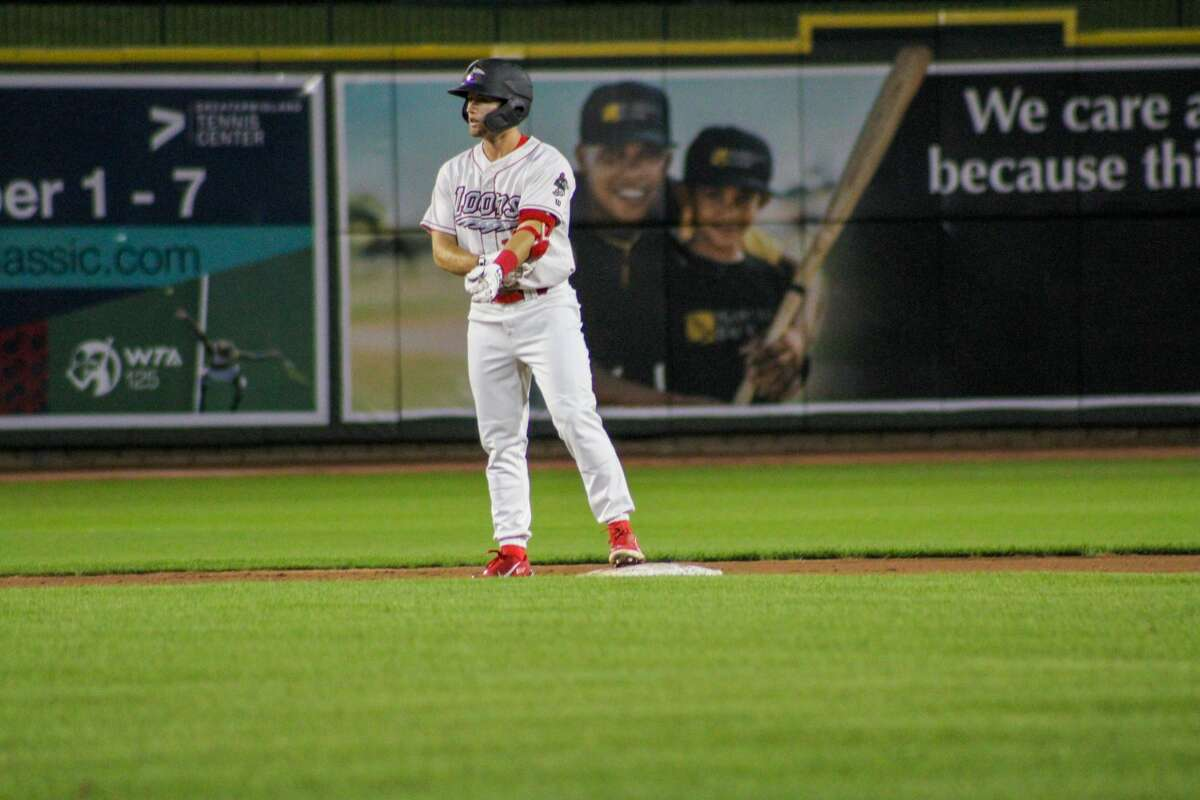 Loons center fielder Jonny DeLuca stands on second after hitting a double against Fort Wayne on Aug. 31 at Dow Diamond (Austin Chastain/austin.chastain@hearstnp.com)