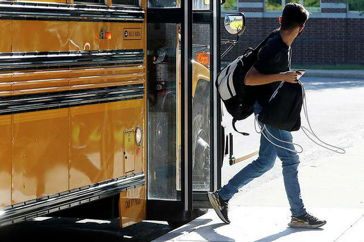 A student arrives for the first day back to school in Woodstock.