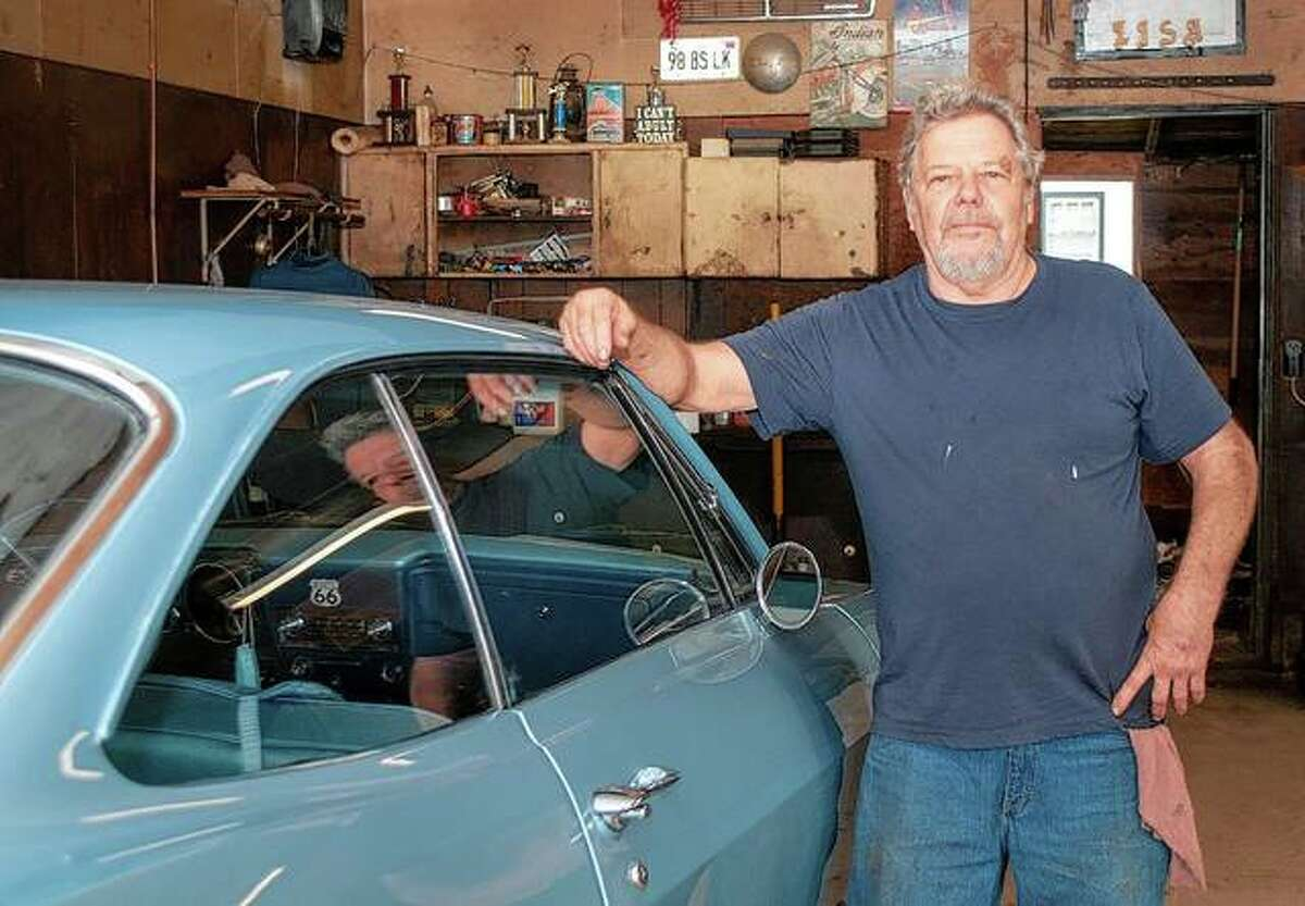 """Terry """"Butch"""" Sumpter stands next to a 1965 Chevrolet Corvair, one of many vehicles on which Sumpter has worked since Frank's Auto opened in 1965. Named after his father, Frank Sumpter, the auto shop will be closing it doors Thursday."""