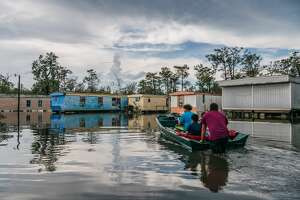 The Maldonado family travel by boat to their home after it flooded during Hurricane Ida on August 31, 2021 in Barataria, Louisiana. Ida made landfall as a Category 4 hurricane on August 29 in Louisiana and brought flooding and wind damage along the Gulf Coast. The remnants of that storm are now making their way to the northeast, and a flash flood warning is in effect for lower and mid-Hudson Valley.
