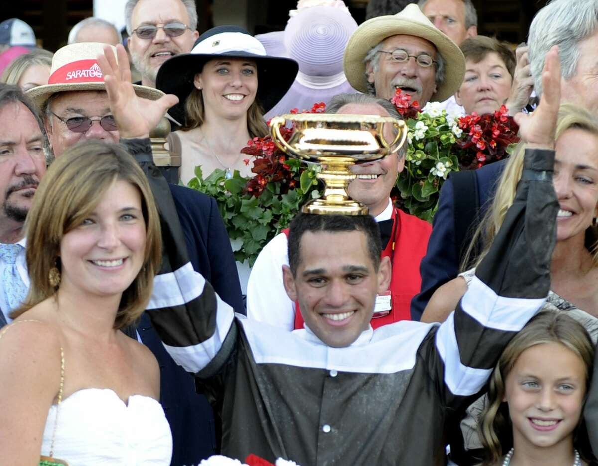 Javier Castellano puts the winner's trophy on his head in the winner's circle after winning the 141st running of The Travers Stakes on Afleet Express at the Saratoga Race Course in Saratoga Springs this evening August 28, 2010. (Skip Dickstein/Times Union)