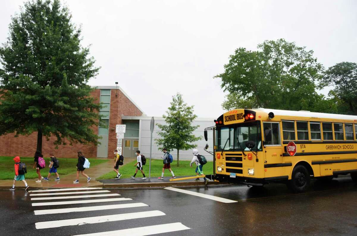 Students enter school on the first day of the 2021-2022 school year at Western Middle School in Greenwich, Conn. Wednesday, Sept. 1, 2021. Greenwich Public Schools students across all grade levels returned for in-person learning Wednesday.
