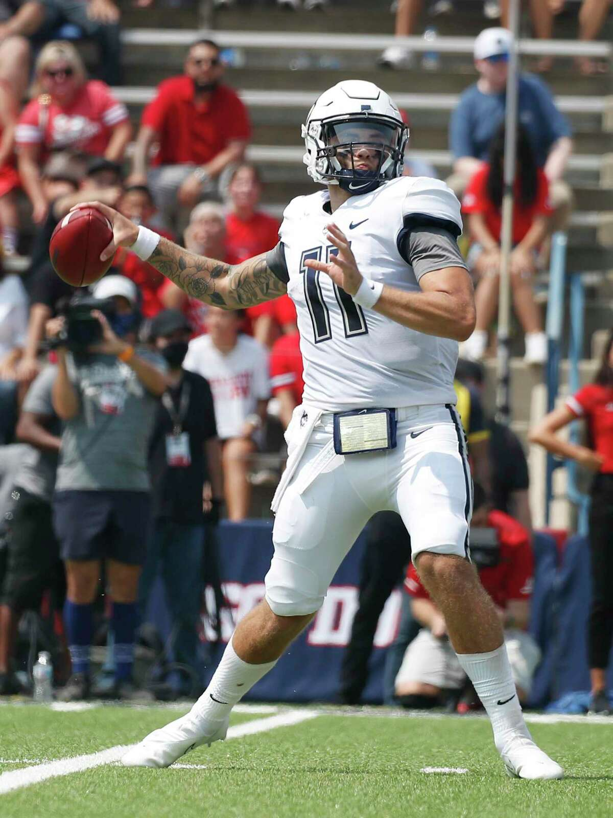 UConn quarterback Jack Zergiotis drops back to pass against Fresno State during the first half of an NCAA college football game in Fresno, Calif., Saturday, Aug. 28, 2021.