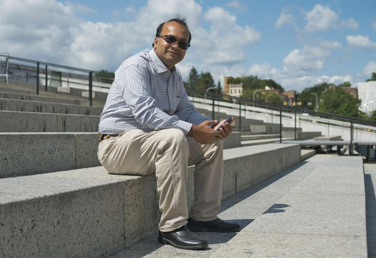 Ripon Roy poses for a photo at the Empire State Plaza on Tuesday, Aug. 31, 2021, in Albany, N.Y. Roy is Bengali and he has helped over 100 Bengali families move to the Capital Region from New York City. (Paul Buckowski/Times Union)