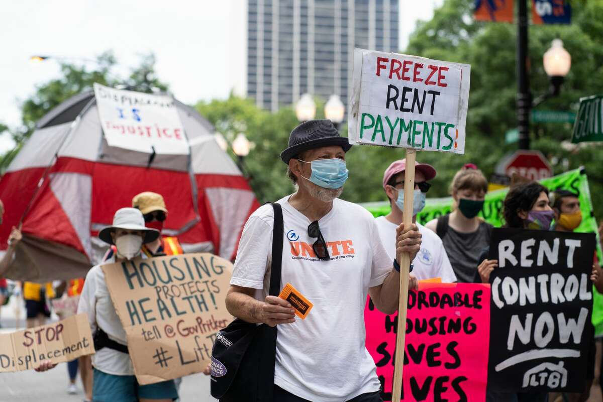 Demonstrators march for housing justice in the Old Town neighborhood in Chicago, IL on June 30, 2020. (Photo by Max Herman/NurPhoto via Getty Images)