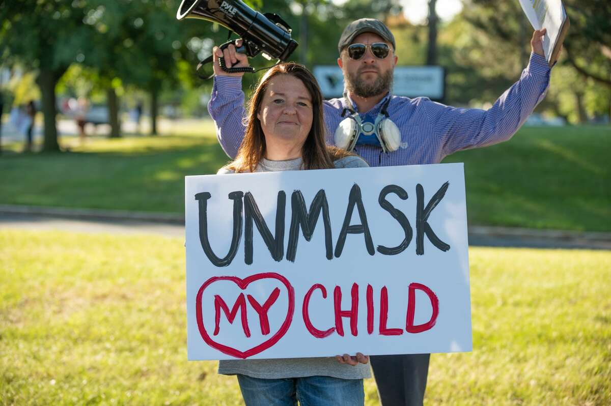 Robin Chritz shows off her sign at the Parents Against MPS Mask Mandate protest at the Midland Public Schools Administration Center on Sept. 1, 2021 (Adam Ferman/for the Daily News)
