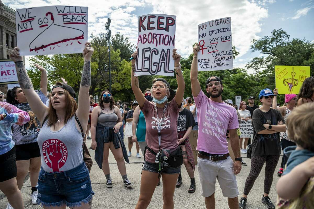 Protesters are seen outside the Texas State Capitol on May 29. A new bill banning abortions after six weeks went into effect Wednesday.