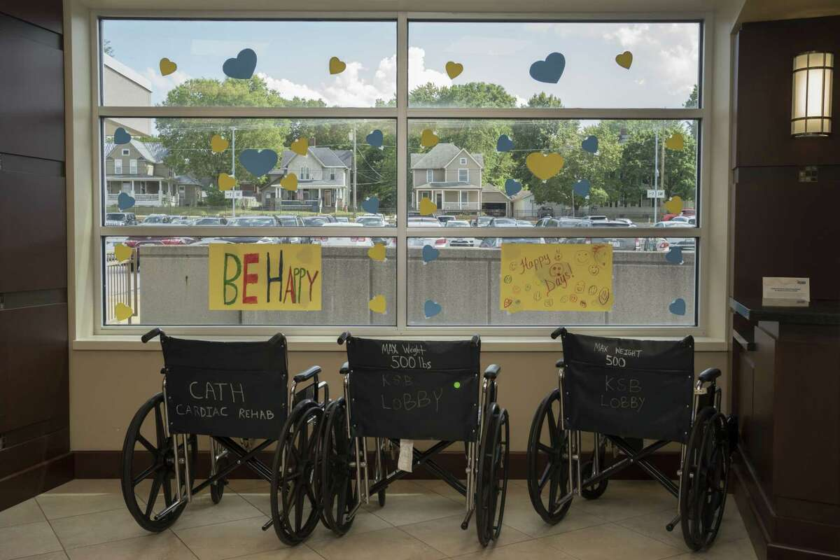 Wheelchairs rest in front of a decorated window at the lobby of Katherine Shaw Bethea Hospital in Dixon, Ill., on August 24, 2021.