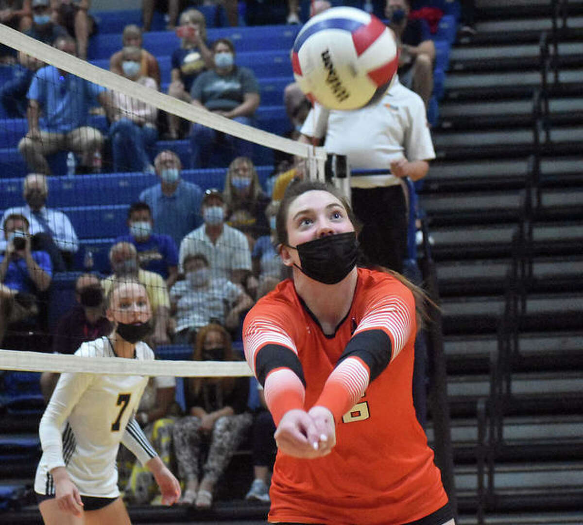 Edwardsville's Lexie Griffin saves the volley near the net during the second game against the O'Fallon Panthers on Tuesday in O'Fallon.