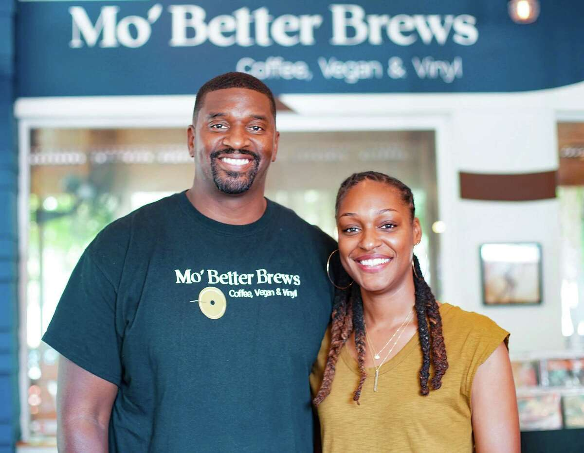 Chasitie and Courtney Lindsay in their Mo'Better Brews restaurant in Houston on Thursday, July 22, 2021. The couple have been creating a vegan empire in a relatively short amount of time in addition to Mo'Better Blues the couple owns Houston Sauce Co, Shopette and Green Zone.