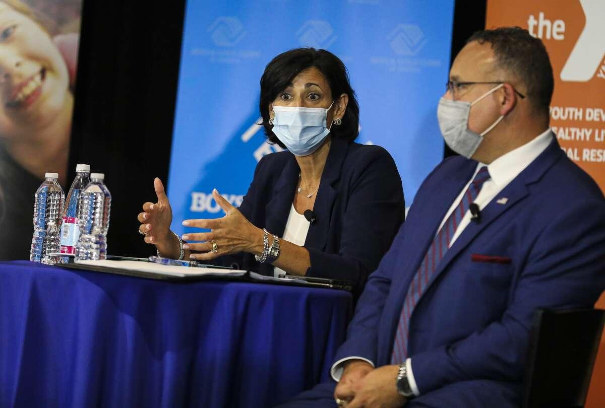 CDC Director Rochelle Walensky talks to community members with U.S. Secretary of Education Miguel Cardona.(Photo by Erin Clark/The Boston Globe via Getty Images)