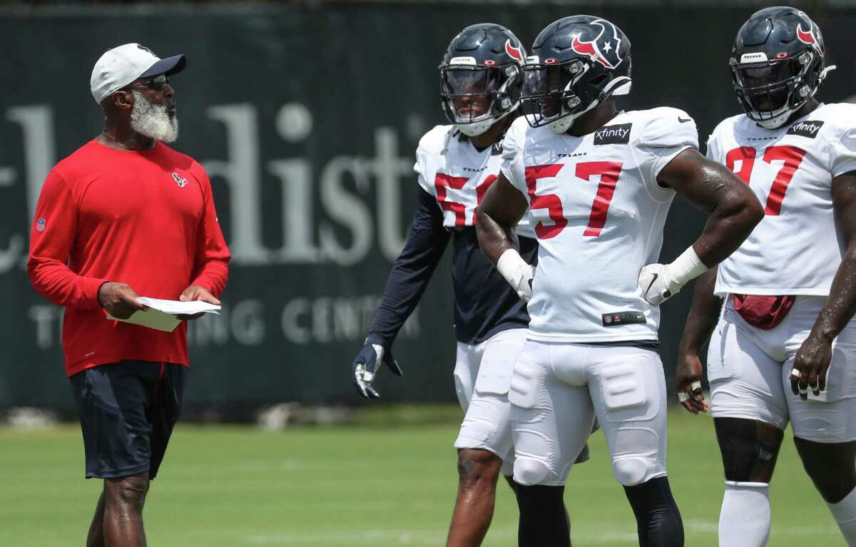 New Texans defensive coordinator Lovie Smith. left, has found a captive audience in players adapting to his 4-3 scheme.