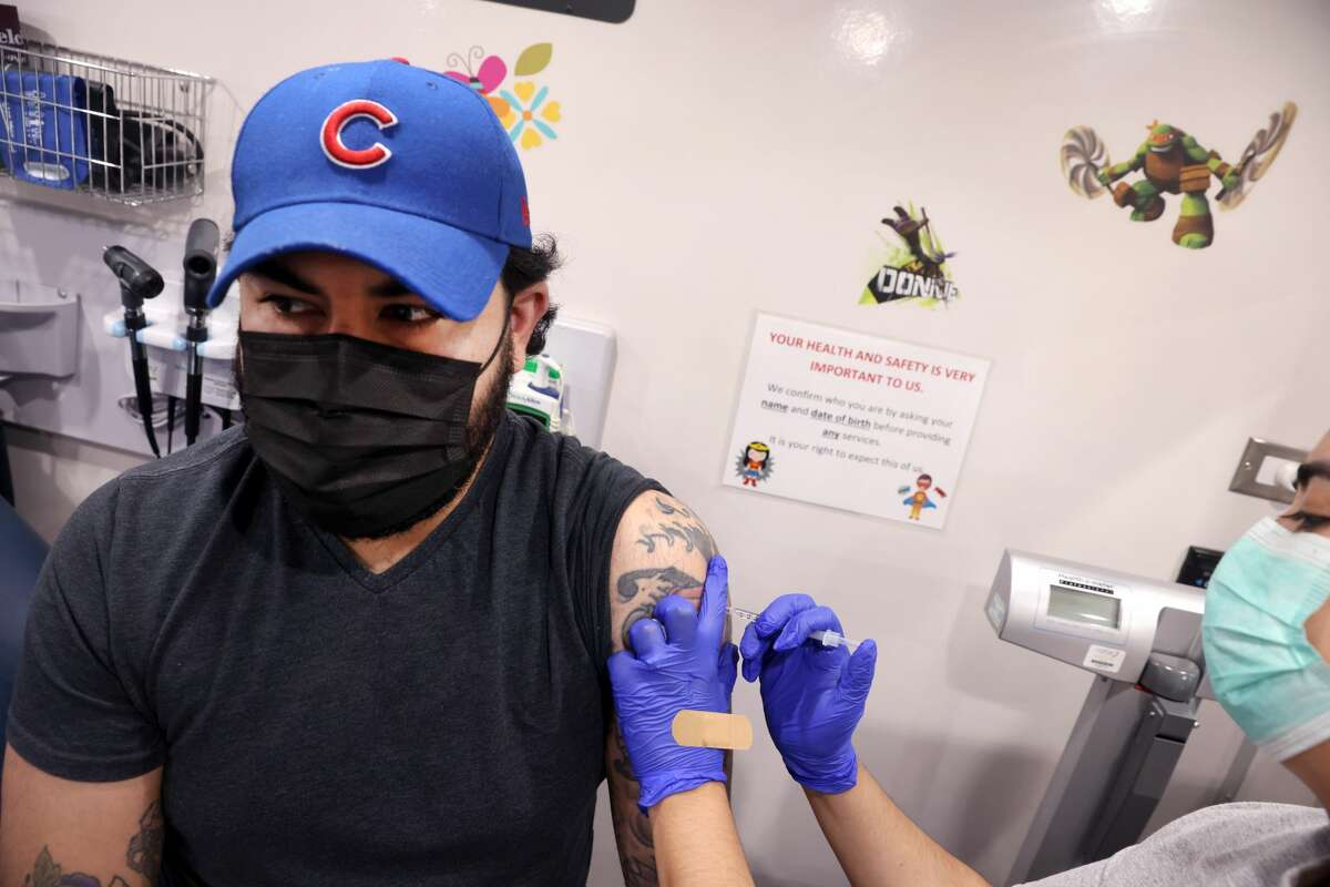Abraham Arellano gets a COVID-19 vaccine at a mobile clinic being run by Humboldt Park Health on May 18, 2021 in Chicago, Illinois. (Photo by Scott Olson/Getty Images)