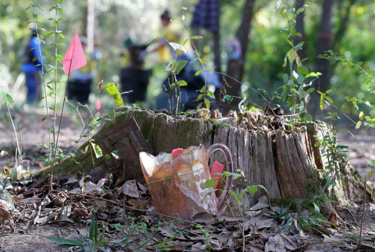 A broken pitcher marks a grave at the Conroe Community Cemetery, Saturday, Nov. 7, 2020, in Conroe. The Conroe Community Cemetery Restoration Project has lead efforts to restore the site, which dates back to the 1890s and includes emancipated slaves, railroad workers, saw mill workers and the only confirmed Buffalo Solider buried in Montgomery County.