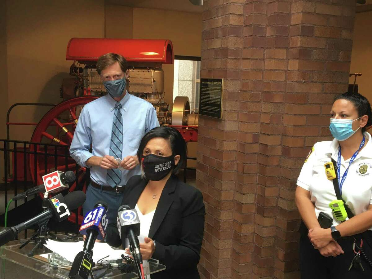 From left, New Haven Mayor Justin Elicker and Health Director Maritza Bond warned that the Health Department is about to begin enforcement inspections related to the city's mask mandate. Acting Fire Marshal Jennifer Forslund also spoke at the City Hall press conference.