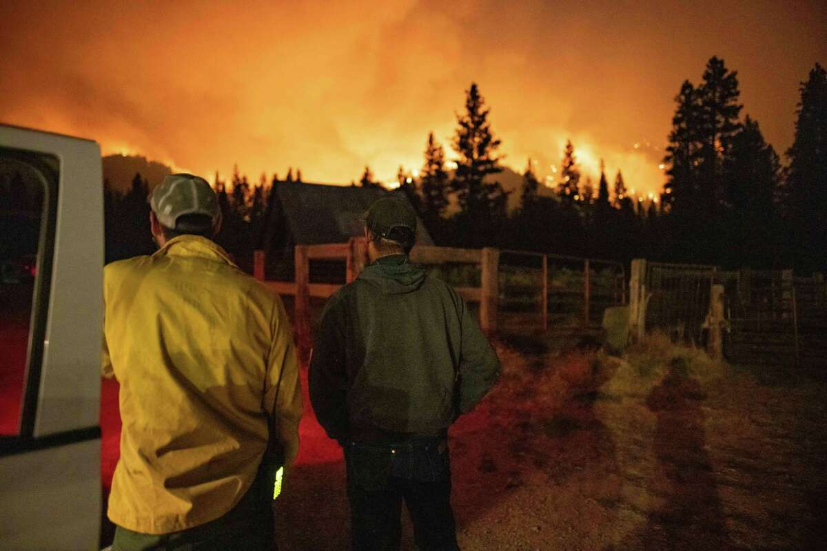 People watch Dixie Fire in Taylorsville, Calif. last month. As the climate warms, and extreme weather becomes more frequent, readers preach a carbon fee and dividend and nuclear power as possible responses.