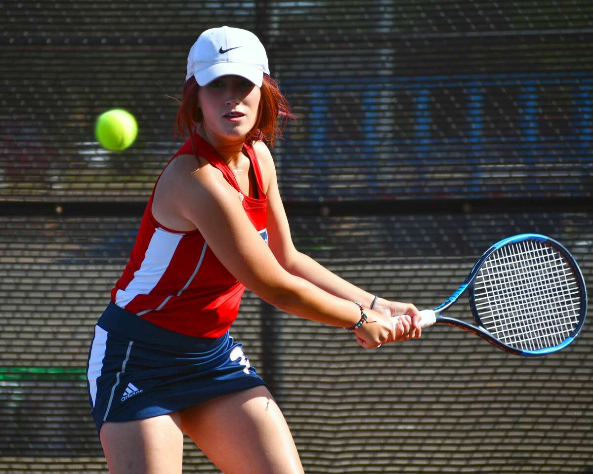 Plainview's CJ Davenport readies her return hit during first flight doubles action against Canyon Randall in a District 3-5A tennis match on Tuesday at Plainview High School.