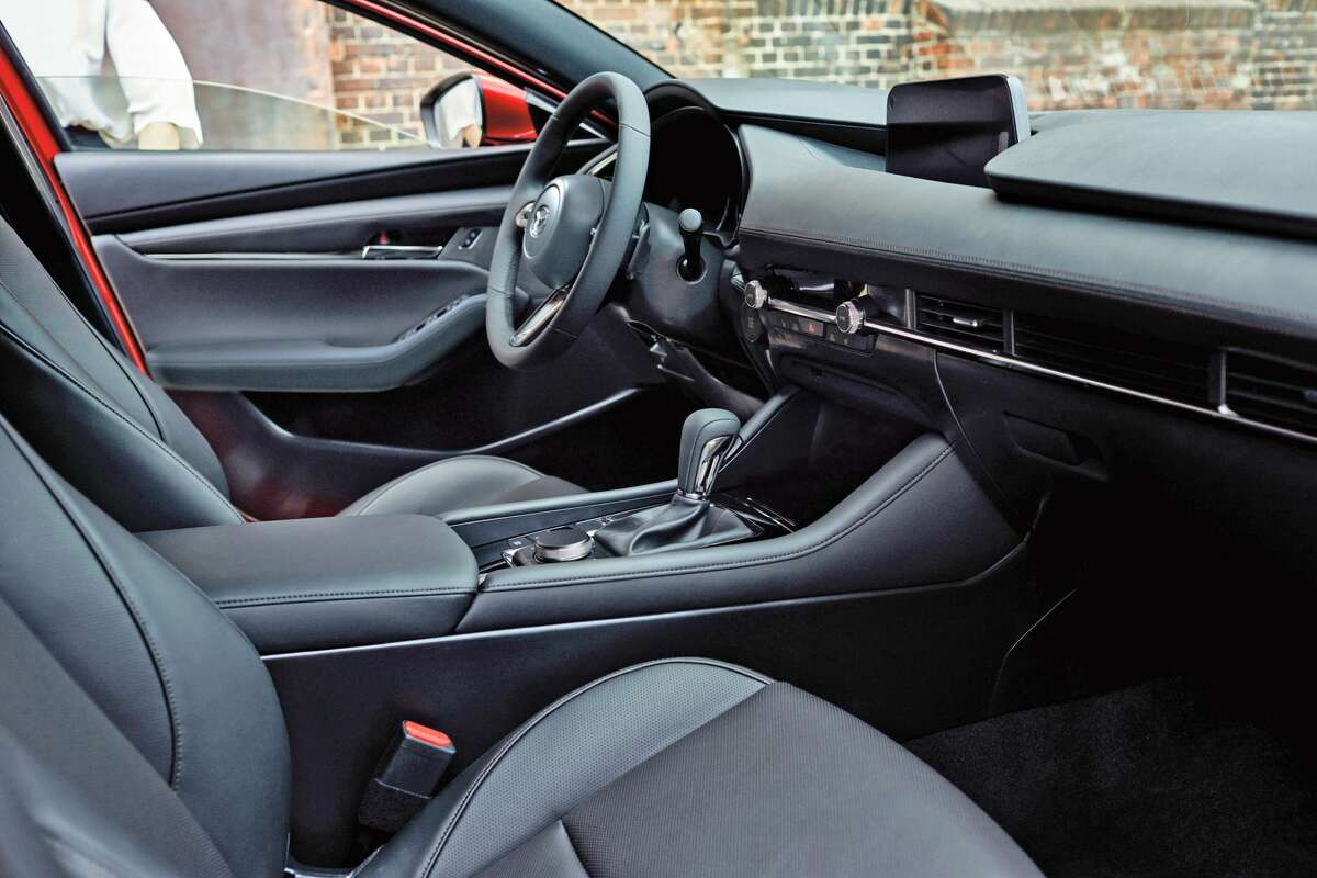The 2021 Mazda3 Turbo Hatchback has room for five and a leather interior.