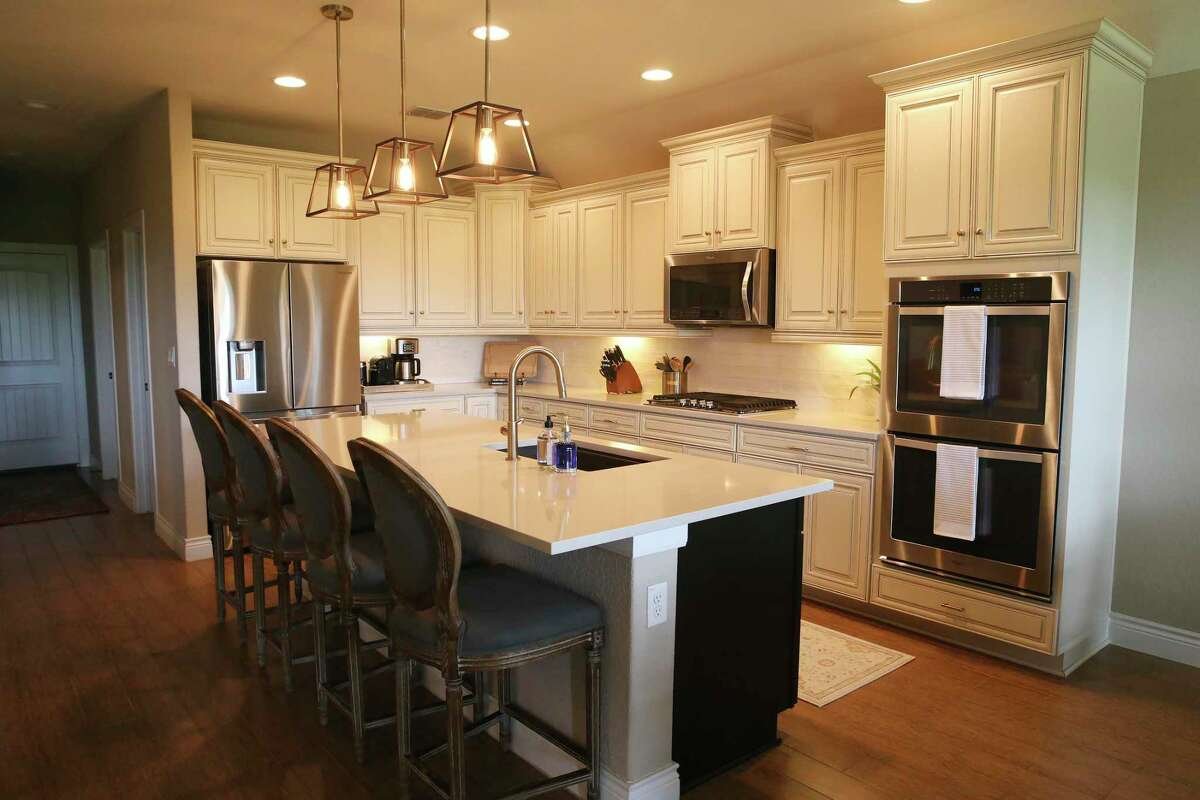 While they kept the cream-colored kitchen cabinets, the Granatos replaced the countertops and backsplash.
