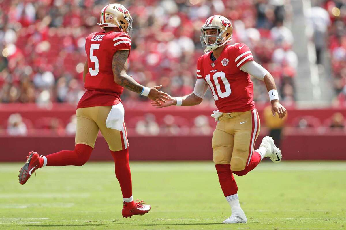 San Francisco 49ers' quarterbacks Jimmy Garoppolo and Trey Lance switch in and out in 2nd quarter against Las Vegas Raiders during NFL preseason game at Levi's Stadium in Santa Clara on Sunday, August 29, 2021.