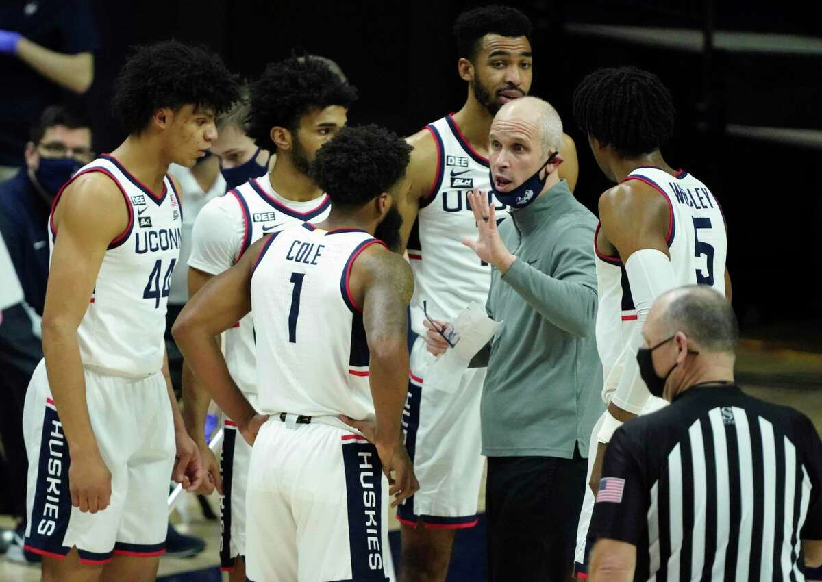 UConn coach Dan Hurley talks to his team during a break in the action against Seton Hall during the first half in February in Storrs.