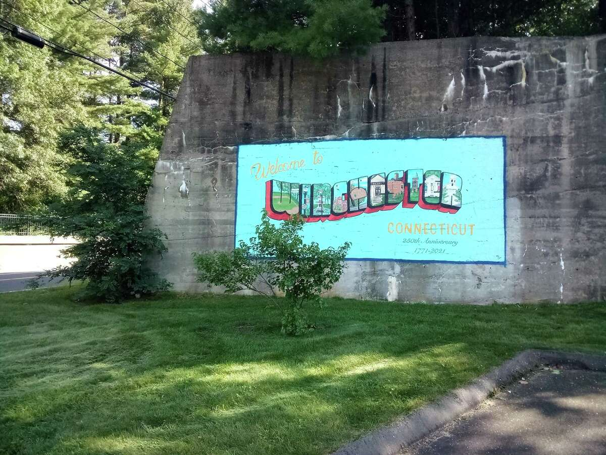 A new mural by artist Ash Royer is visible to drivers as they drive in or leave town. Royer painted the postcard-shaped mural on the rockface off Rowley Street near the skateboard park entrance.