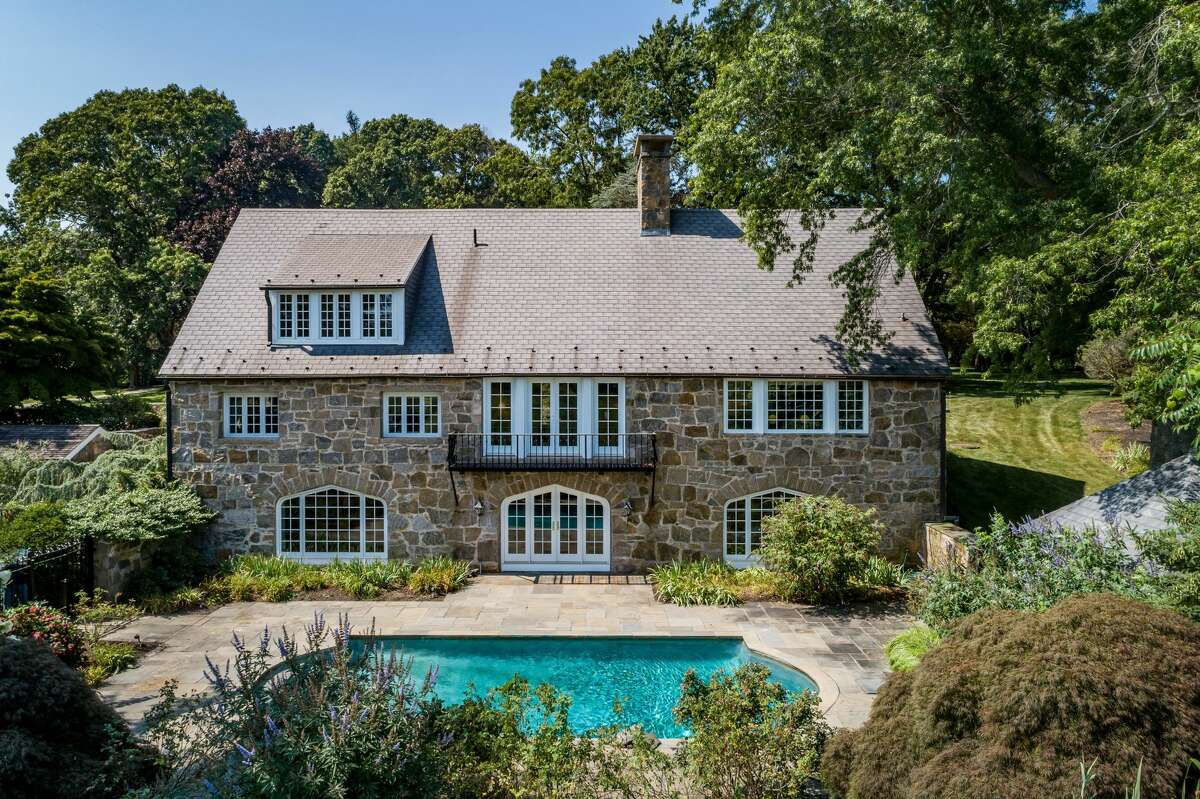 The main residence of the 1 and 3 Neck Road property in Old Lyme, Conn. has a saltwater pool in the backyard.