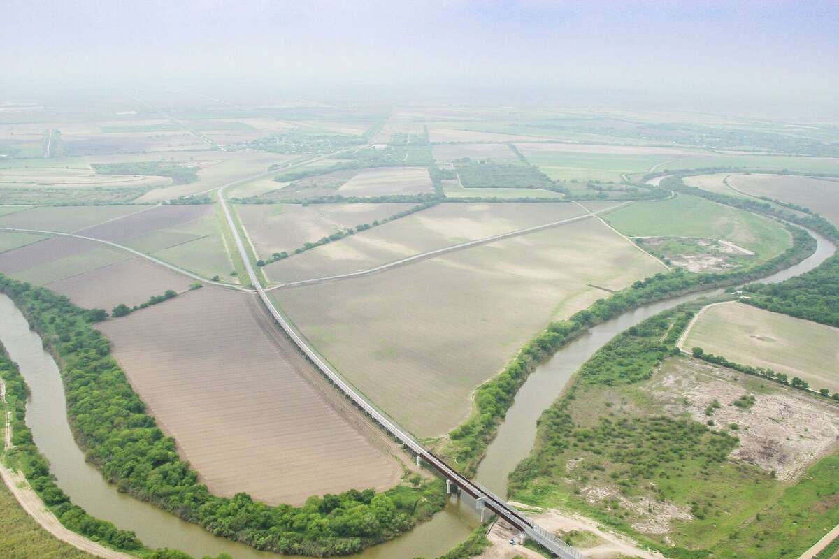 An aerial view shows the West Rail Bridge as it crosses the Rio Grande and into Mexico from the United States. The rail relocation project spanned 15 years and cost more than $120 million. It is the first U.S.-Mexico rail bridge in 100 years. Though international rail makse up a small part of goods that pass across the U.S. border with Mexico, regional business leaders say the bridge is key to the long-term success of the region.