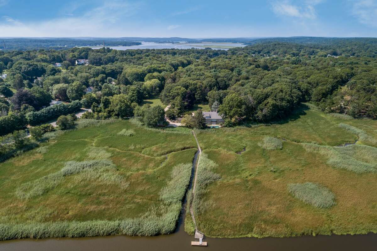 The 1 and 3 Neck Road property in Old Lyme, Conn. sits on over 14 acres of land, about 5 acres of which listing agent Jennifer Caulfield said is marsh land.