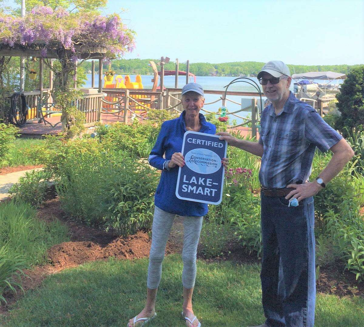 In June, Marty Podskoch of the East Hampton Conservation & Lake Commission, right, presented Gladys Yeager, owner of The Happiest Paddler marina, with the Lake Smart Award for managing her property to benefit Lake Pocotopaug.