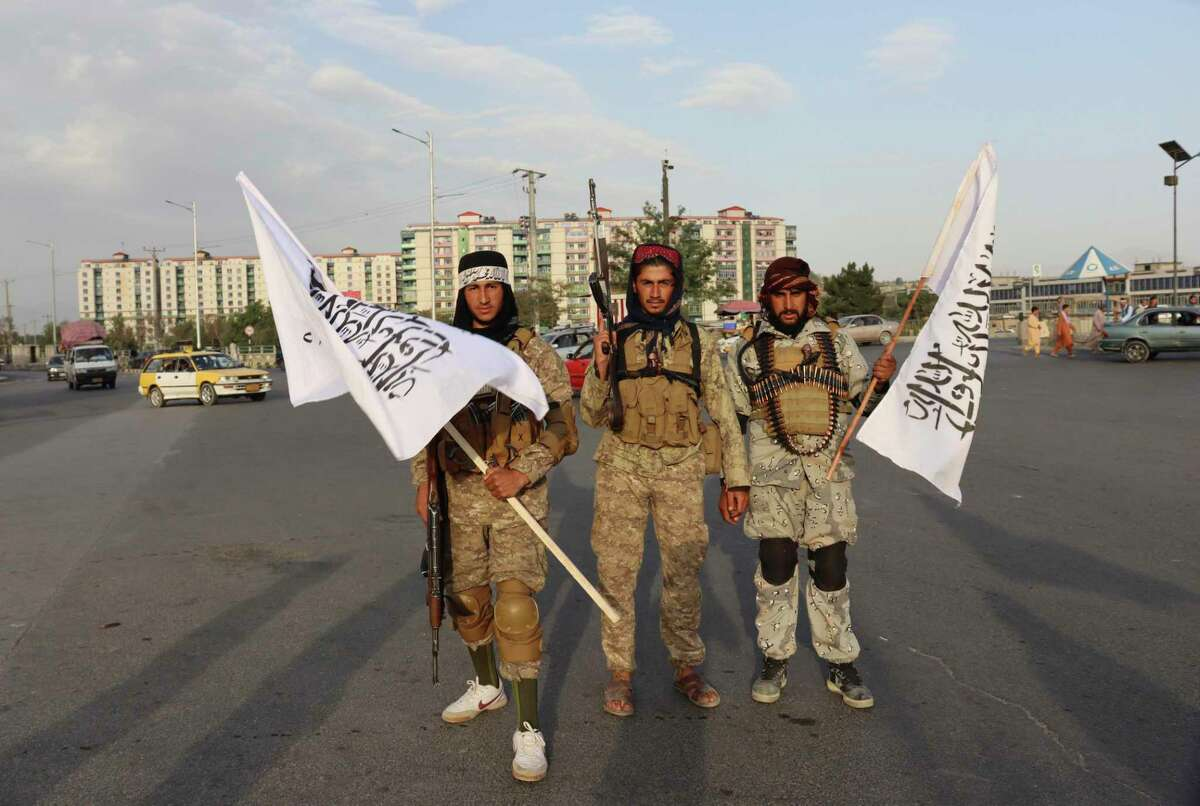 Taliban fighters hold Taliban flags in Kabul, Afghanistan Monday. Sorry Biden supporters, there's no way to spin this outcome as a success.