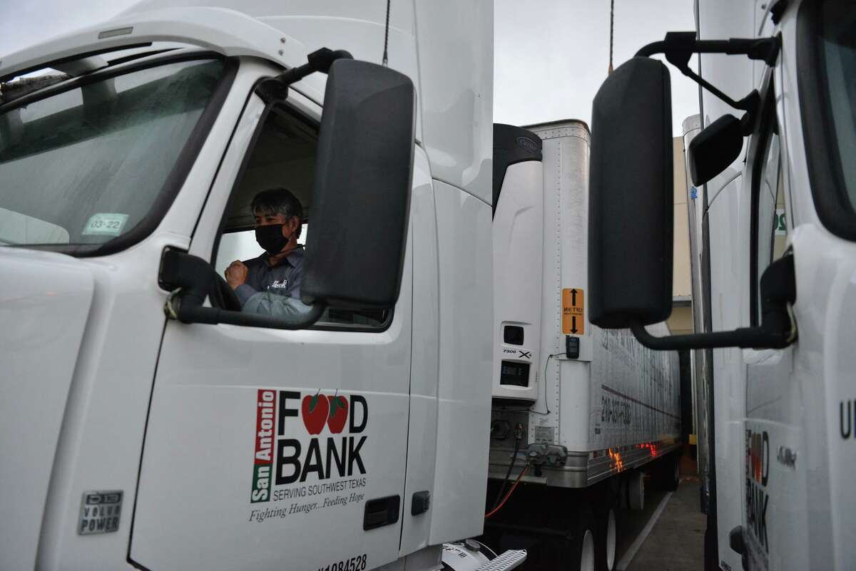Driver Dave Casillas prepares to leave the San Antonio Food Bank early Wednesday morning with a load of relief supplies bound for Louisiana hurricane victims.