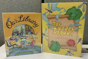 """""""The Library Dragon"""" by Carmen Agra Deedy takes place in a school library, where the librarian is a dragon who doesn't believe children should be allowed near the books. One day, a young girl wanders in and begins reading. She teaches the dragon that books are for everyone.(Courtesy photo)"""