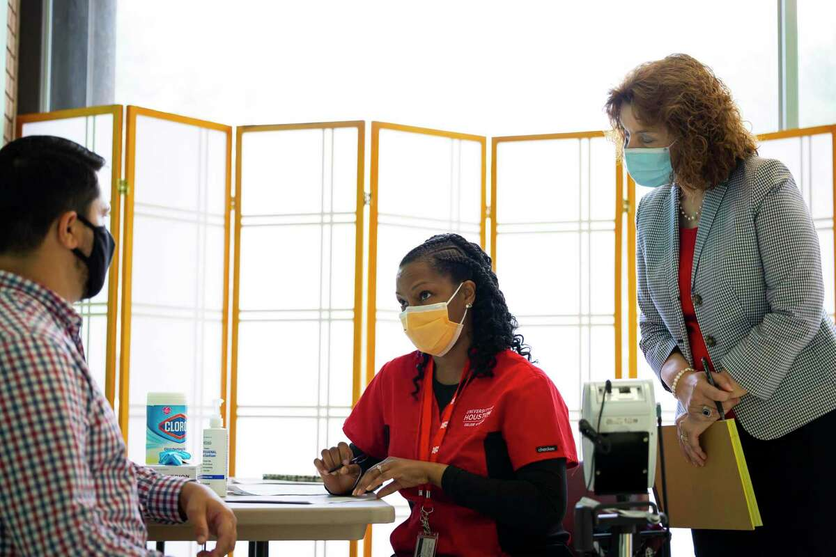 University of Houston graduate and nurse Juanita Ward, center, asks screening questions during a practice run at a new clinic featuring both nurse-run care and telehealth services on Monday, Aug. 30, 2021. The clinic is located in one of St. Paul's United Methodist downtown buildings on Fannin Street and is a partnership between the church and the University of Houston.