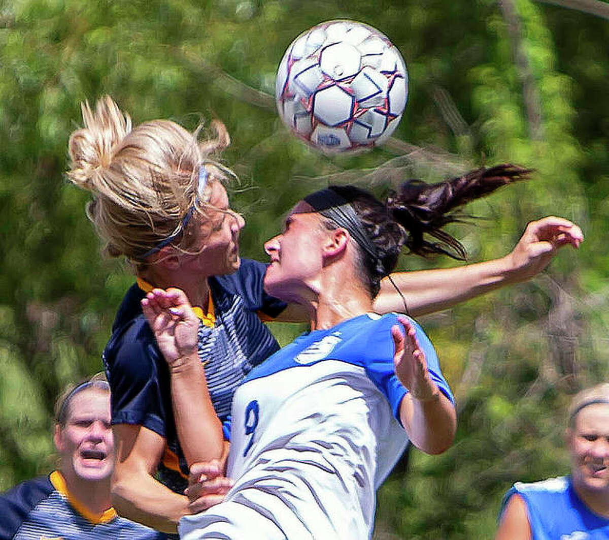 LCCC's Paige Bauer (9) battles for a header with a Johnson County player during Sunday action at LCCC. The Trailblazers were scheduled to play host to Illinois Central College Thursday, but the game was postponed because of field conditions following Wednesday night's rain.
