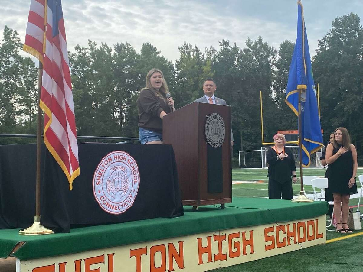 Aine Saranich opens the Shelton school convocation on Tuesday, singing the National Anthem. Aine is the daughter of school Superintendent Ken Saranich.