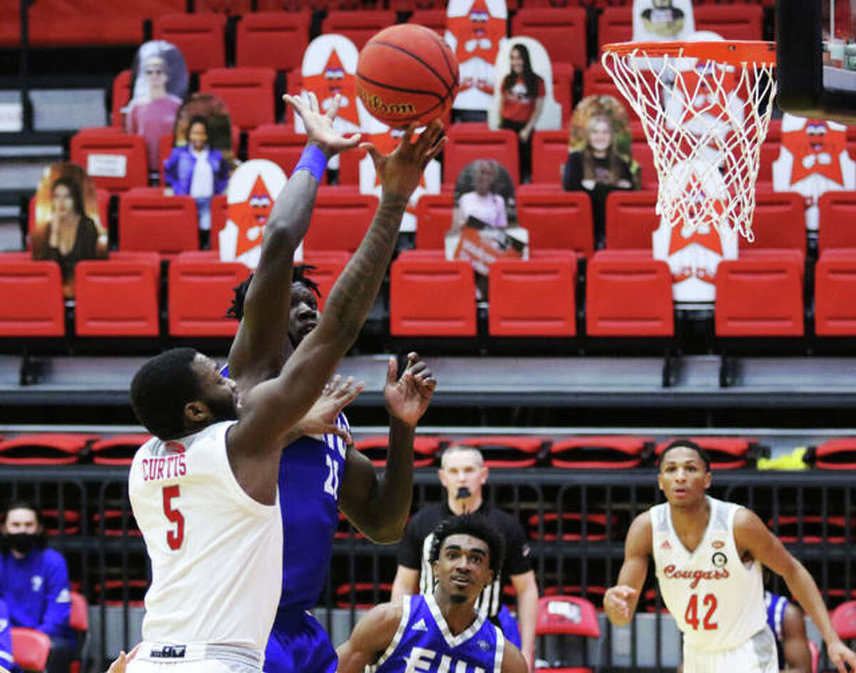 SIUE's Carlos Curtis (5) takes the ball to the rim past an Eastern Illinois defender during a game last season at First Community Arena in Edwardsville. Curtis, a Milwaukee native, will go back home with the Cougars in the 2021-22 season opener against Marquette in Milwaukee.