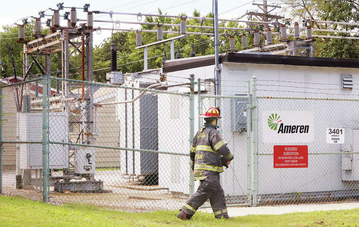 An Alton firefighter walks around the Rodgers Substation at 3401 Brown St. after neighbors reported a very loud bang and smoke coming from the substation. The smoke was gone when firefighters arrived but they noted that an insulator on top of a large transformer had blown up, likely causing the smoke and noise.